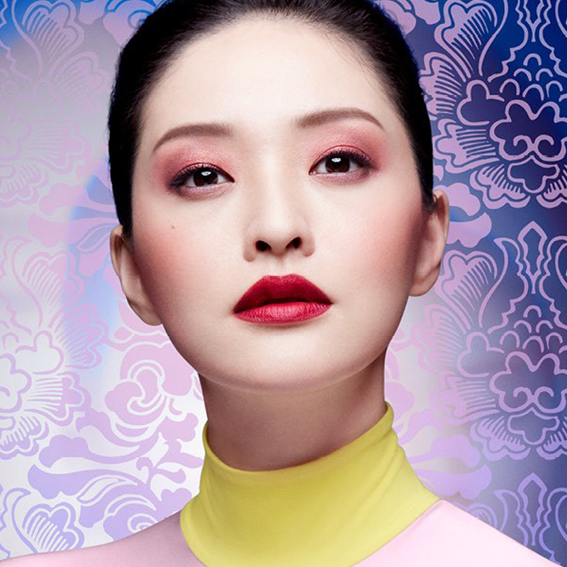 Beautiful oriental woman with her makeup just perfected