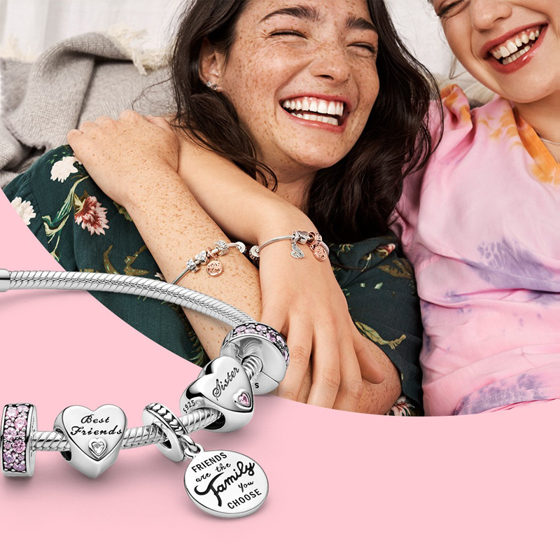 "Two friends hanging out, one wearing beautiful silver bracelet with charms about ""Best Friends"" from Pandora"