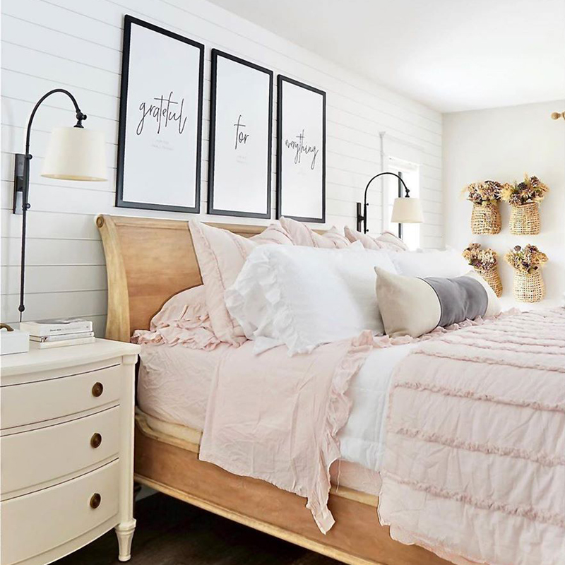 Beautiful bedroom scene with pillows and quilt on bed